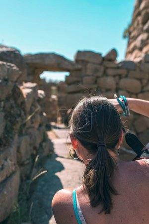 tourist photographing nuraghe site