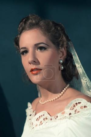 bride in white dress and pearl necklace