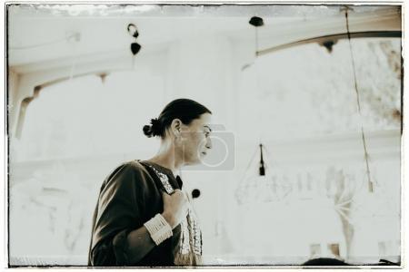 woman standing inside  furniture shop
