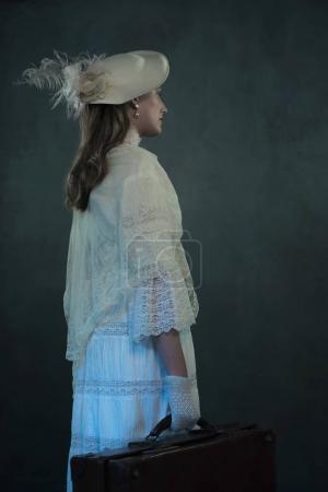 Victorian girl in white dress