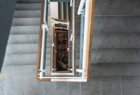 industrial stairwell with armchair