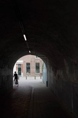 woman cycling in tunnel