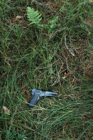 Pistol lying in grass