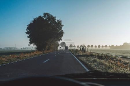 Highway in rural misty landscape