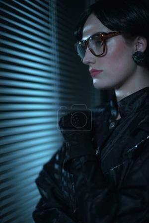 woman in office at night