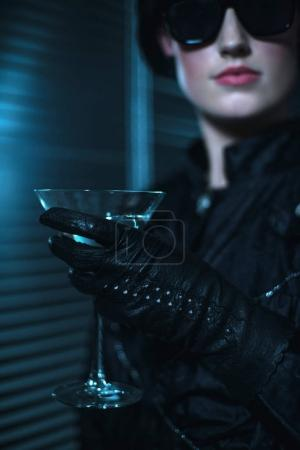 woman holding cocktail glass.