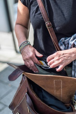 Female hands inspecting wallet