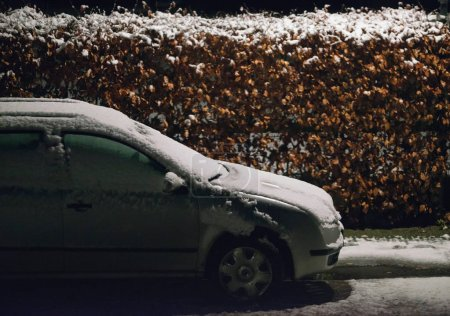 Parked car covered in snow