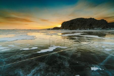 Pattern on ice of lake Baikal during sunset. Siberia Russia