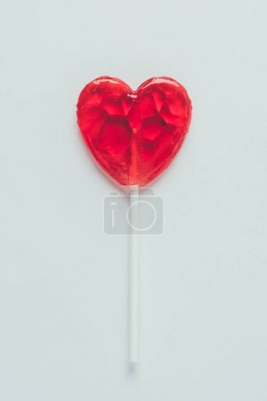 top view of heart shaped lollipop isolated on white, valentines day concept