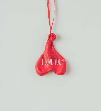 Photo for Top view of flipped over deflated balloon on ribbon with words i love you isolated on white - Royalty Free Image