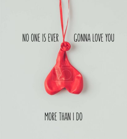 Top view of  deflated balloon on ribbon with text no one is ever gonna love you more than i do isolated on white