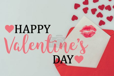 Foto de Top view of happy valentines day postcard with lips print in envelope isolated on white - Imagen libre de derechos