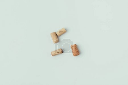 top view of arrangement of bottle corks isolated on grey