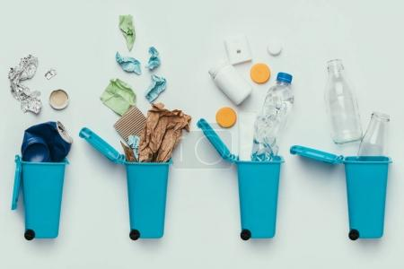 Photo for Top view of trash bins and assorted garbage isolated on grey, recycle concept - Royalty Free Image