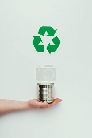 partial view of man holding can with recycle sign isolated on grey