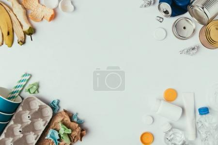 flat lay with arranged different types of garbage isolated on grey
