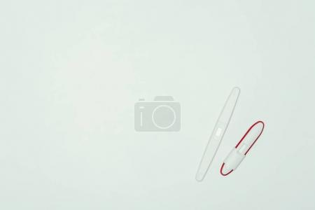 top view of two pregnancy tests isolated on grey