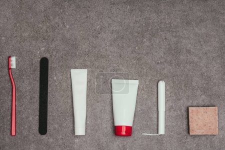 top view of arrangement of feminine hygiene supplies on grey surface