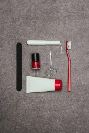 top view of arrangement of various feminine hygiene supplies on grey surface