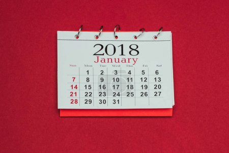 close up view of 2018 calendar isolated on red