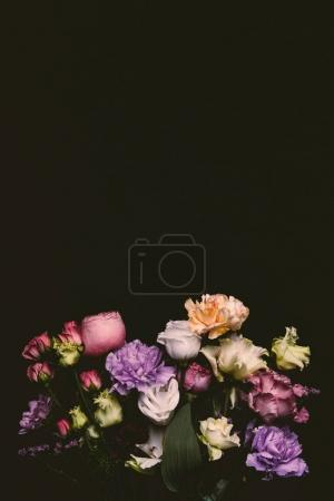 Photo for Beautiful tender fresh blooming flowers isolated on black - Royalty Free Image