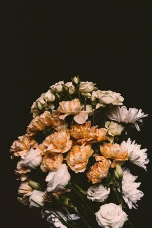 close-up view of beautiful tender pink flower bouquet isolated on black