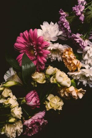 close-up view of beautiful tender various flowers isolated on black