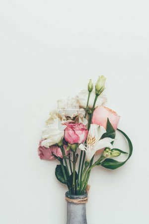 close-up view of beautiful tender flower bouquet in bottle isolated on grey