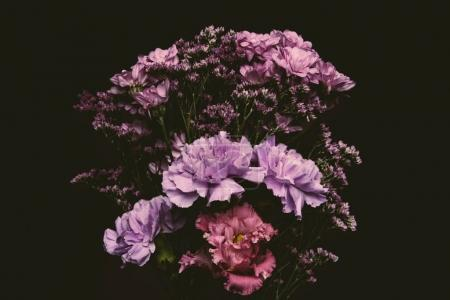 close-up view of beautiful tender pink and purple flowers isolated on black