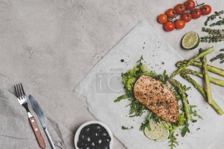 gourmet healthy meal with baked meat and vegetables on grey