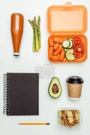 flat lay with vegetables and drinks isolated on white