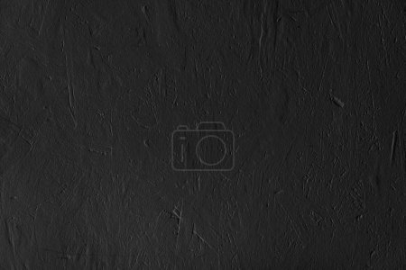 Black textured surface abstract background