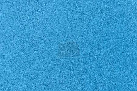 Photo pour Surface du mur de lumière texturé brut bleu - image libre de droit