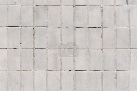 Building wall with white tiles background