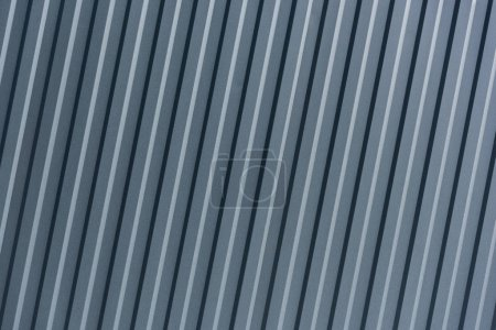 Industrial background of striped metal surface