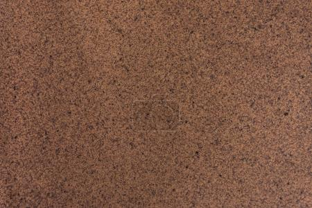 Brown grainy surface abstract background