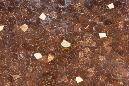 Surface of wall with brown tiles background