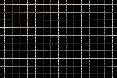 Industrial metal grit over black background