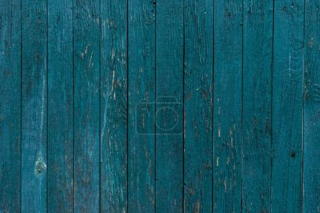 Photo for Wooden planks painted in blue background - Royalty Free Image