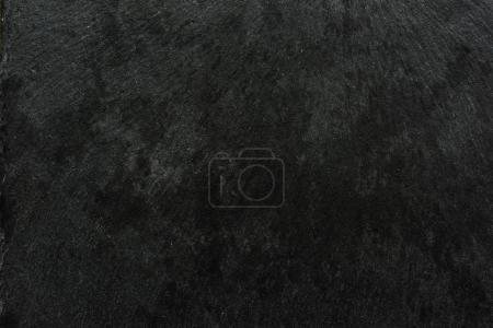 Dark textured surface abstract background