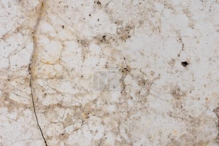Photo pour Mur en marbre texture légère avec fond de fissures - image libre de droit