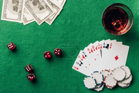 Gambling concept with with cards and dice on casino table