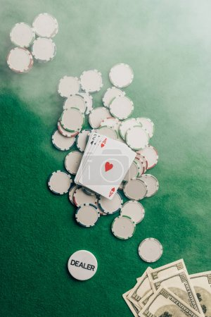 Gambling concept with with cards and chips on casino table