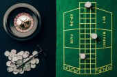 Gambling concept with chips and roulette on casino table