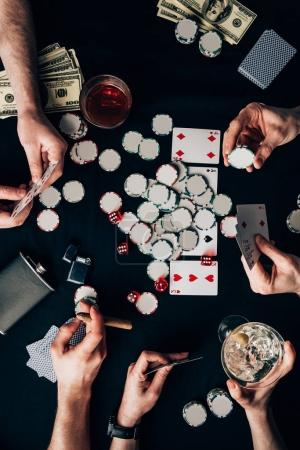 Photo for Men and woman playing poker by casino table with cards and chips - Royalty Free Image