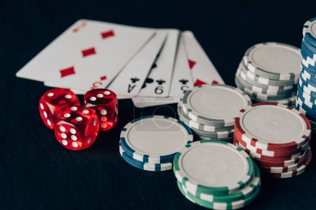 Photo for Dice with playing cards and chips on casino table - Royalty Free Image