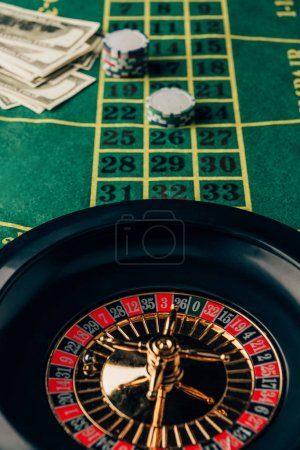 Casino table with roulette and placed chips