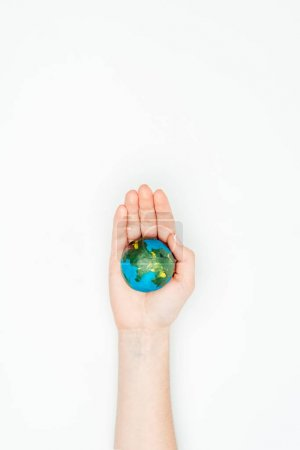 cropped image of woman holding earth model on hand isolated on white, earth day concept