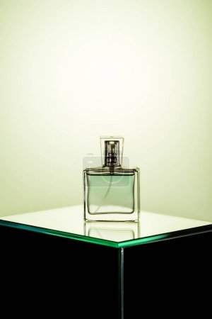 bottle of womans fragrance on glass table